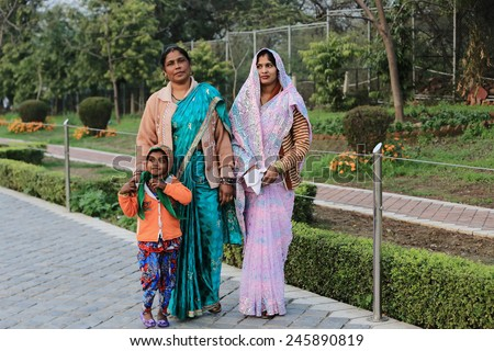 Two indian women with child at the streets of New Delhi. 21 February 2013.  India - stock photo