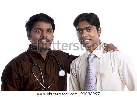 Two Indian young doctors posing to the camera.
