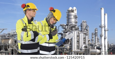 Two industrial guards checking the safety around the site, - stock photo