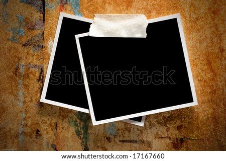 Two instant photo frames on a grungy wooden background - stock photo