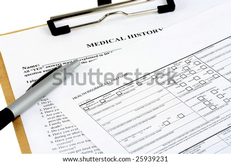 Two insurance forms on a clipboard with a pen.