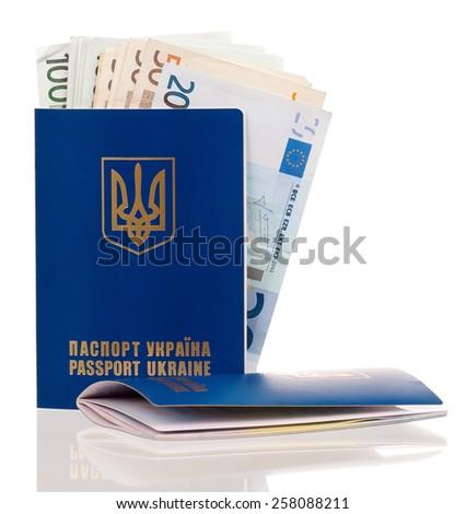 Two international Ukrainian passport with Euro banknotes isolated on background - stock photo