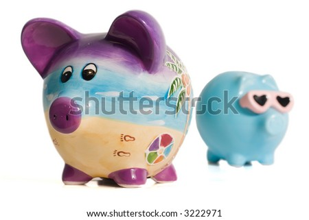 Two isolated piggy banks on a white background - stock photo