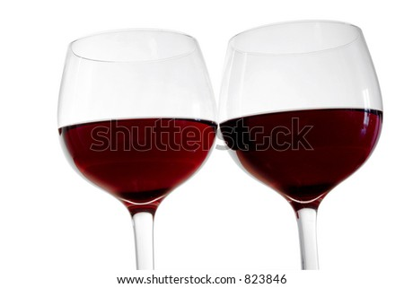Two isolated red wine glasses - stock photo