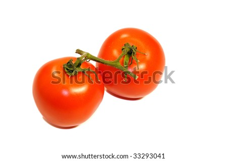 Two isolated tomatoes on a white background - stock photo
