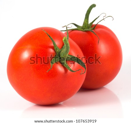 Two isolated tomatoes on white background - stock photo