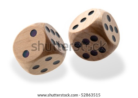 Two isolated wooden dice tumbling with black spots - stock photo