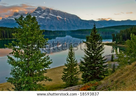 Two Jack Lake with Mt Rundle reflection in Banff - stock photo