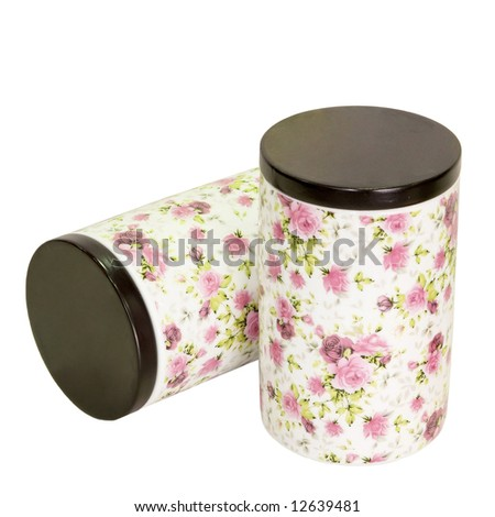 Two jars for kitchen with floral decor isolated - stock photo
