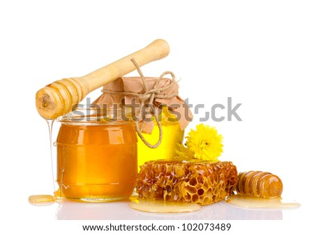 two jars of honey, honeycombs and wooden drizzler isolated on white - stock photo