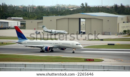 Two jet airplanes at US airport - stock photo