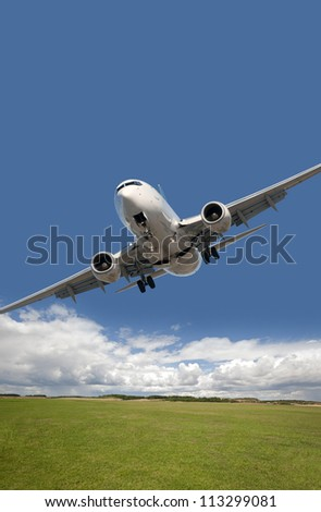 Two jet engine aircraft above the field - stock photo