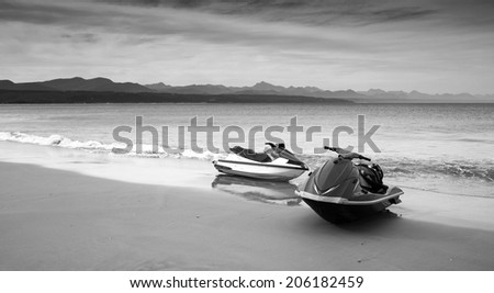 Two jet skis on an overcast day - stock photo