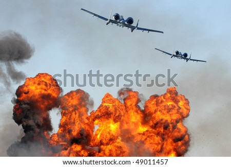 Two jetfighters in a ground attack with fire and smoke - stock photo