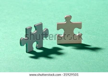 Two jigsaw puzzle pieces standing on their edges