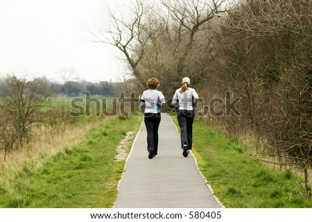 two joggers on country path - stock photo