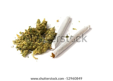 two joints and a stash of marijuana on white background - stock photo