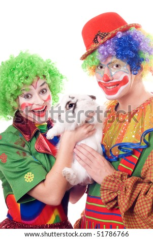 Two joyful clown with a white rabbit. Isolated - stock photo