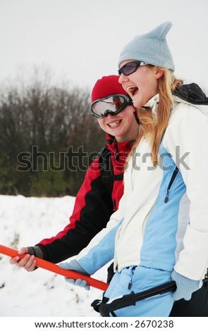 Two joyful girls on lift - stock photo