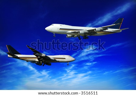 Two jumbo jets on a blue sky. - stock photo