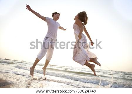 Two jumping at dawn - stock photo