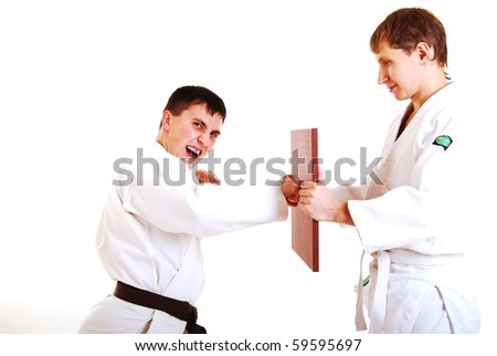Two karatekas on a white background. - stock photo