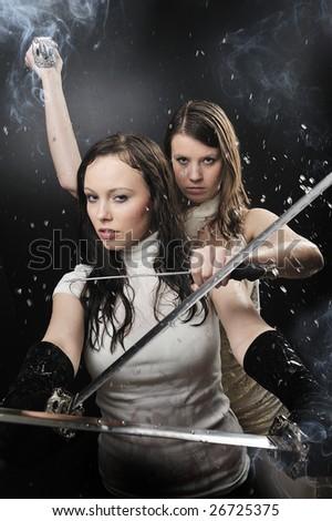 Two katana warrior isolated on black background - stock photo