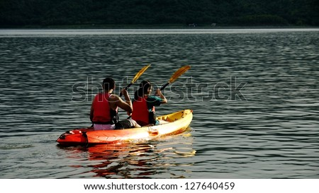 Two Kayakers with Life Vests or Life Jackets. - stock photo