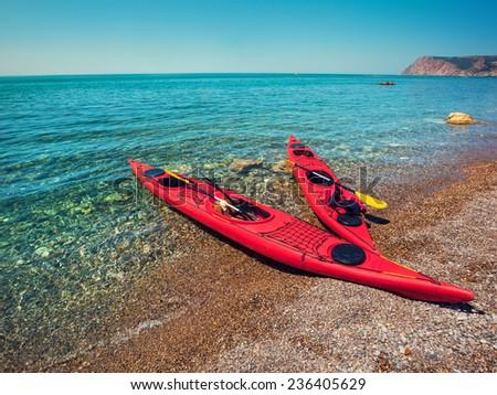 Two kayaks on the beach. - stock photo