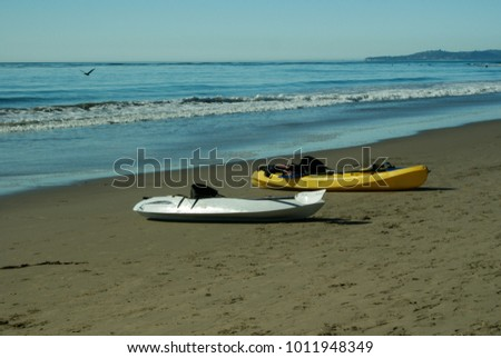 two kayaks on the sand at the beach
