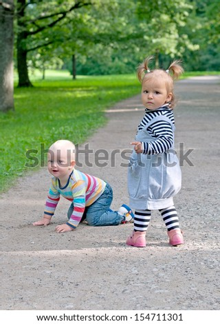 two kid walking in park