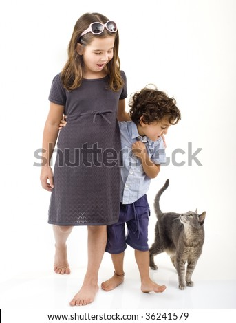 two kids and a cat isolated on white - stock photo