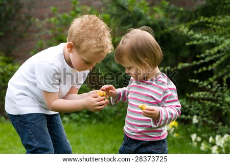 Two kids are sharing their candy