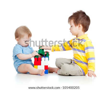 two kids brothers play together, isolated on white background
