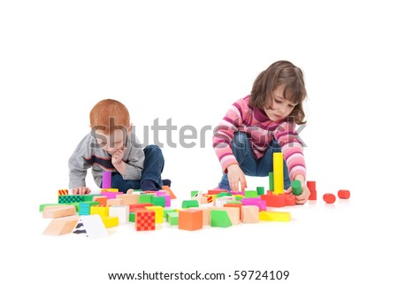 Two kids building block towers. Isolated on white with shadows - stock photo