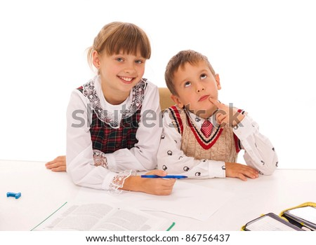 two kids drawing on the floor - stock photo
