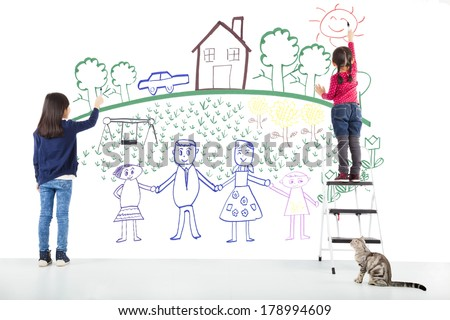 two kids drawing their dream on the white wall - stock photo