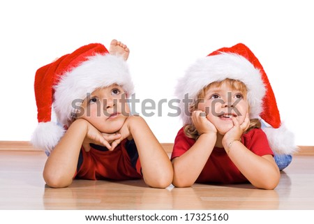 Two kids dreaming about christmas - stock photo