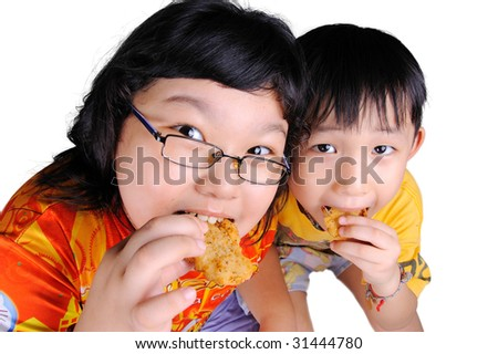 two kids eating fish and chips snack - stock photo