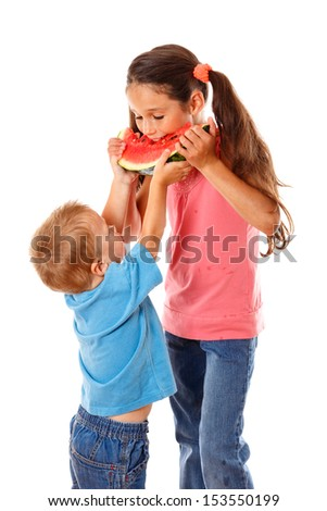 Two kids eating one watermelon together, isolated on white - stock photo