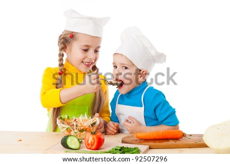 Two kids eating salad, isolated on white - stock photo