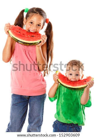 Two kids eating watermelon together, isolated on white - stock photo