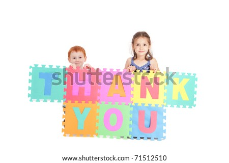 Two kids holding up sign saying thank you. Isolated on white. - stock photo