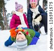Two kids is sledging with mother in winter-landscape. Focus on the boy. - stock photo