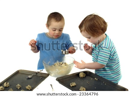 Two kids make chocolate chip cookies - stock photo
