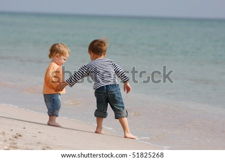 two kids on beach