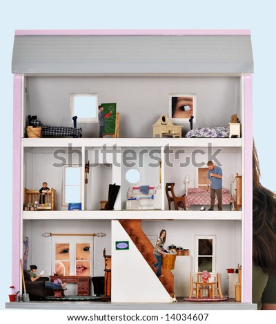 Two kids peeking in a dollhouse where a real family of five is working and playing. - stock photo