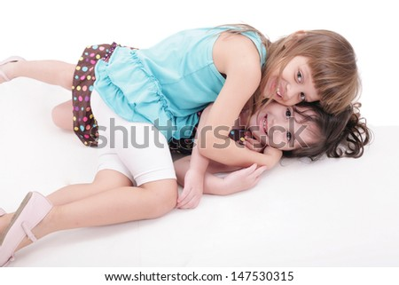 two kids play together, isolated on white background