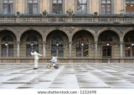 two kids playing on square, Prague, Czech Republic