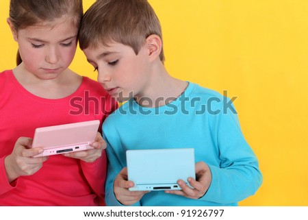 Two kids playing video games. - stock photo